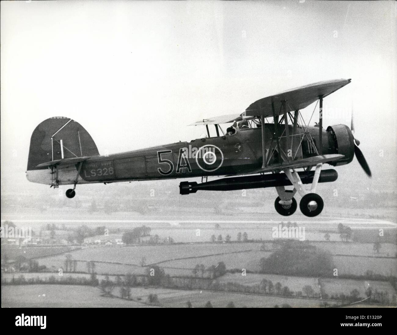 Feb. 26, 2012 - Swordfish flies again for the Navy.: The last airworthy survivor of the Fleet Air Arm's best-known wartime aircraft, the Swordfish, flying again at Yeovilton, Somerset, yesterday, with the aid of an engine from the Imperial War Museum. The Swordfish is to fly at many future air displays. The 1943-built torpedo bomber was grounded last July after its Pegasus engine had worn out. - Stock Image