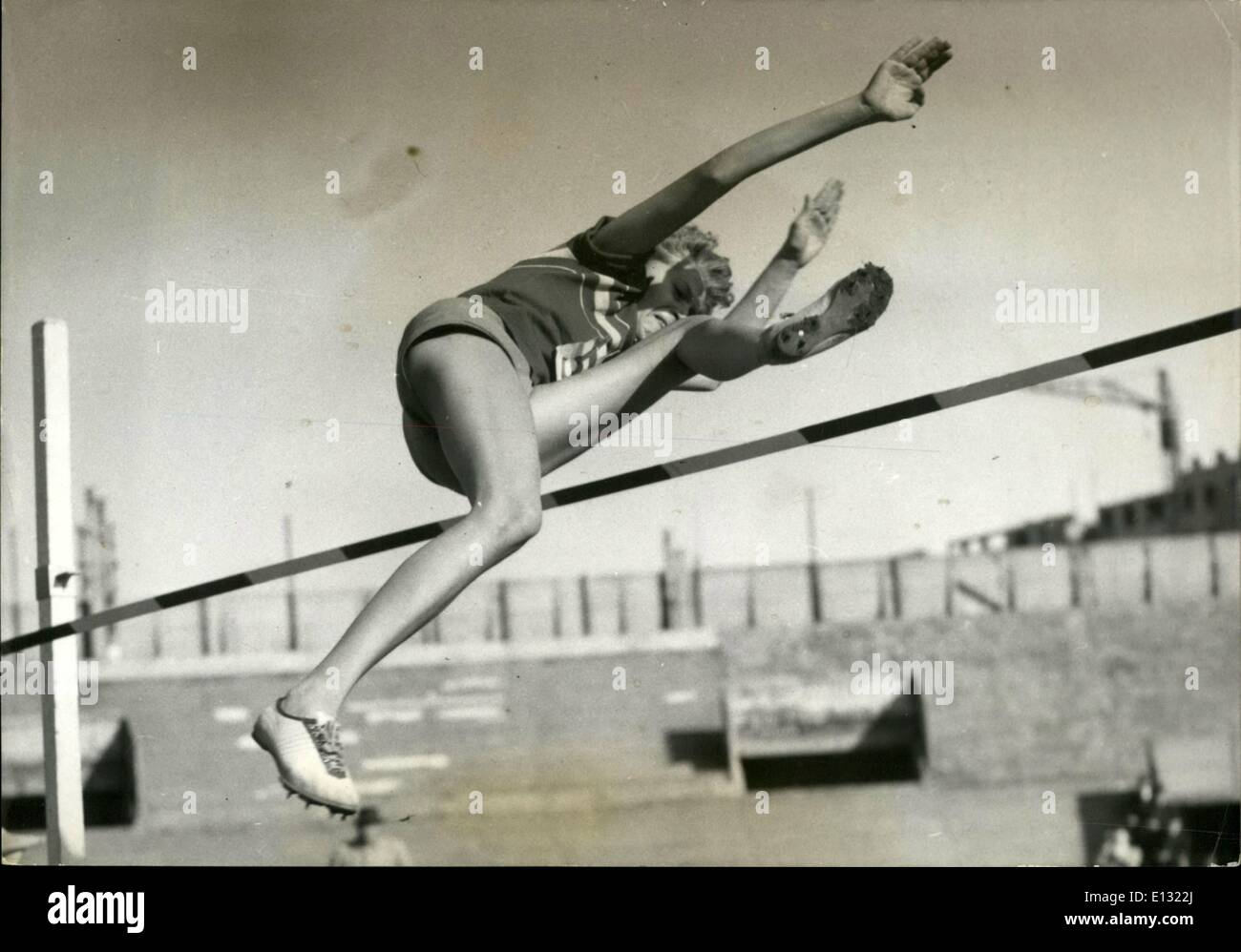 Feb. 26, 2012 - At the track meet between France, Germany, and Romania that was just held in Colombes, I. Balas (Romania), World Champion in the high jump, easily beat all of his opponents. Will the young Romanian win a gold medal at the Olympics in Melbourne? She is pi - Stock Image
