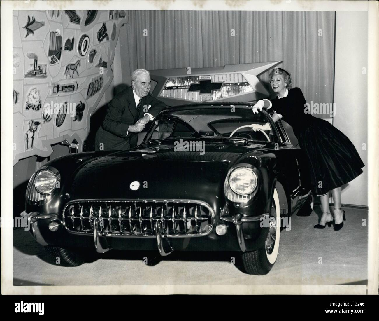 Feb. 26, 2012 - General Motors Motorama of 1954 opened in New York at the Waldorf Astoria with H.H. Curtice, GM President, who announced a one billion dollar GM expansion program, as host. Attending were Dinah Shore, shown here with T.H. Keating, General Manager of the Chevrolet Division, examining Chevrolet's Corvette ''Corvair'' coupé one of the 11 ''dream'' cars introduced at the show. - Stock Image