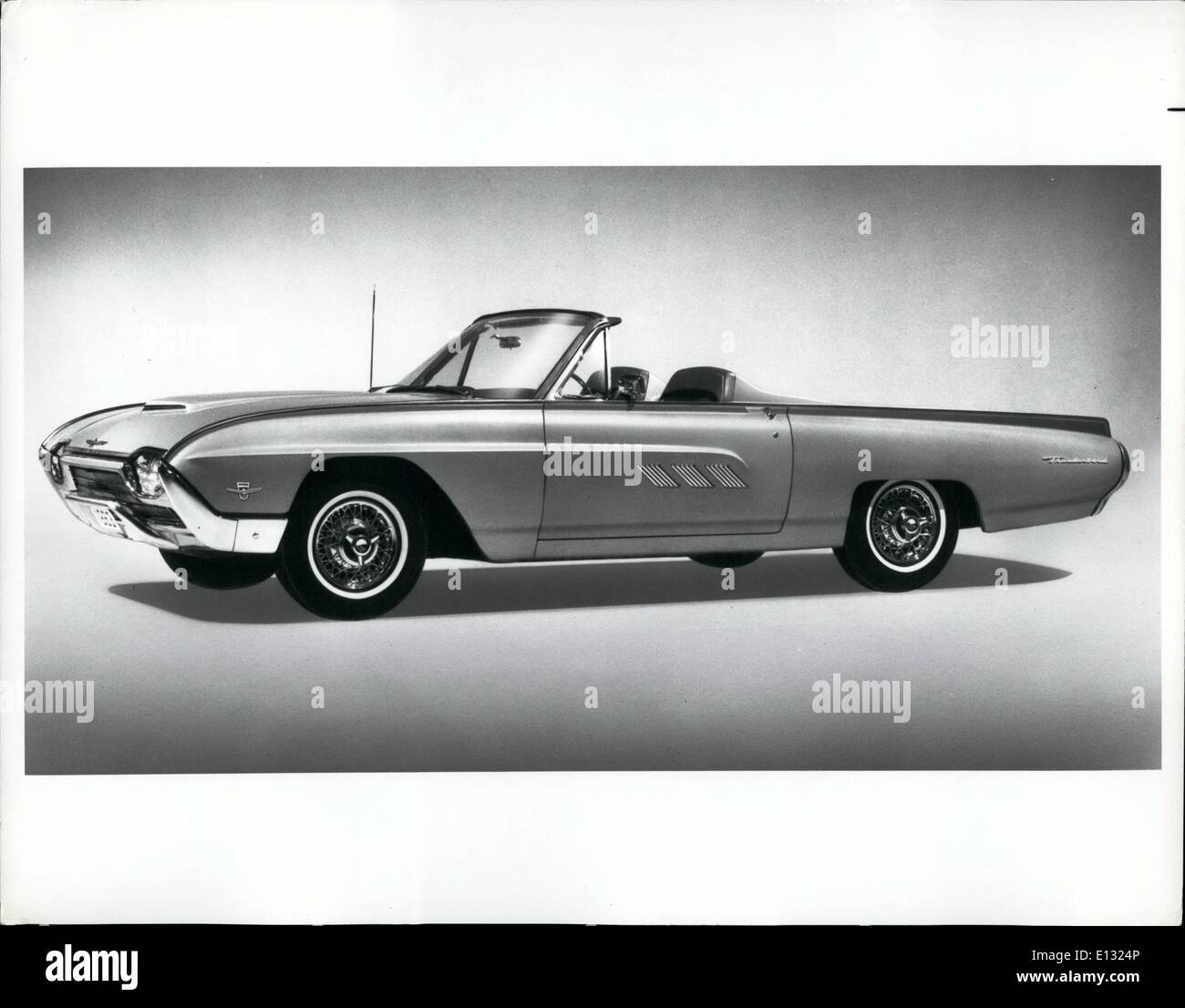 Feb. 26, 2012 - A unique experience in ''top down'' motoring is offered in the Thunderbird sports roadster for 1963. With its automatic convertible top gliding back completely out of sight into the trunk with a touch of a dashboard switch, the sports roadster, like the convertible, retains its classic silhouette even when the top is down. A tonneau cover over the entire rear portion of the passenger compartment transforms the four-seat Thunderbird into a sporty two-seater. The roadster features head rests, wire spoke wheels and an assist bar for passenger convenience - Stock Image