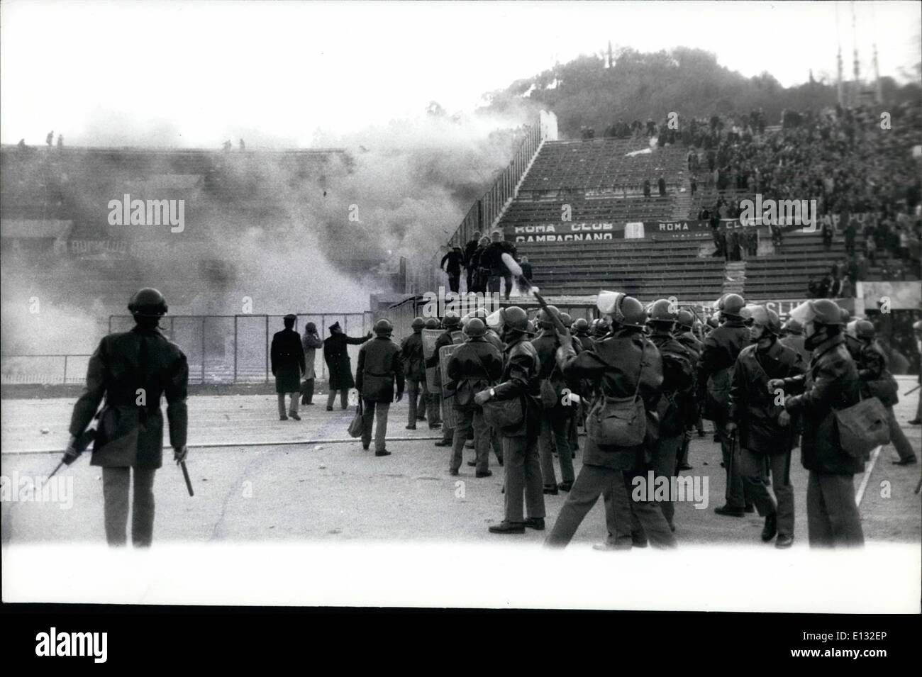 Feb. 26, 2012 - Rome, 12-1-75. Serious rioting broke out between fans and police during the Italian professional football championship in Rome between the Juventus (team of Turin) and Roma PBC caused by the decision of the referee. OPS: Police use teargas bombs to disperse the crowd. - Stock Image