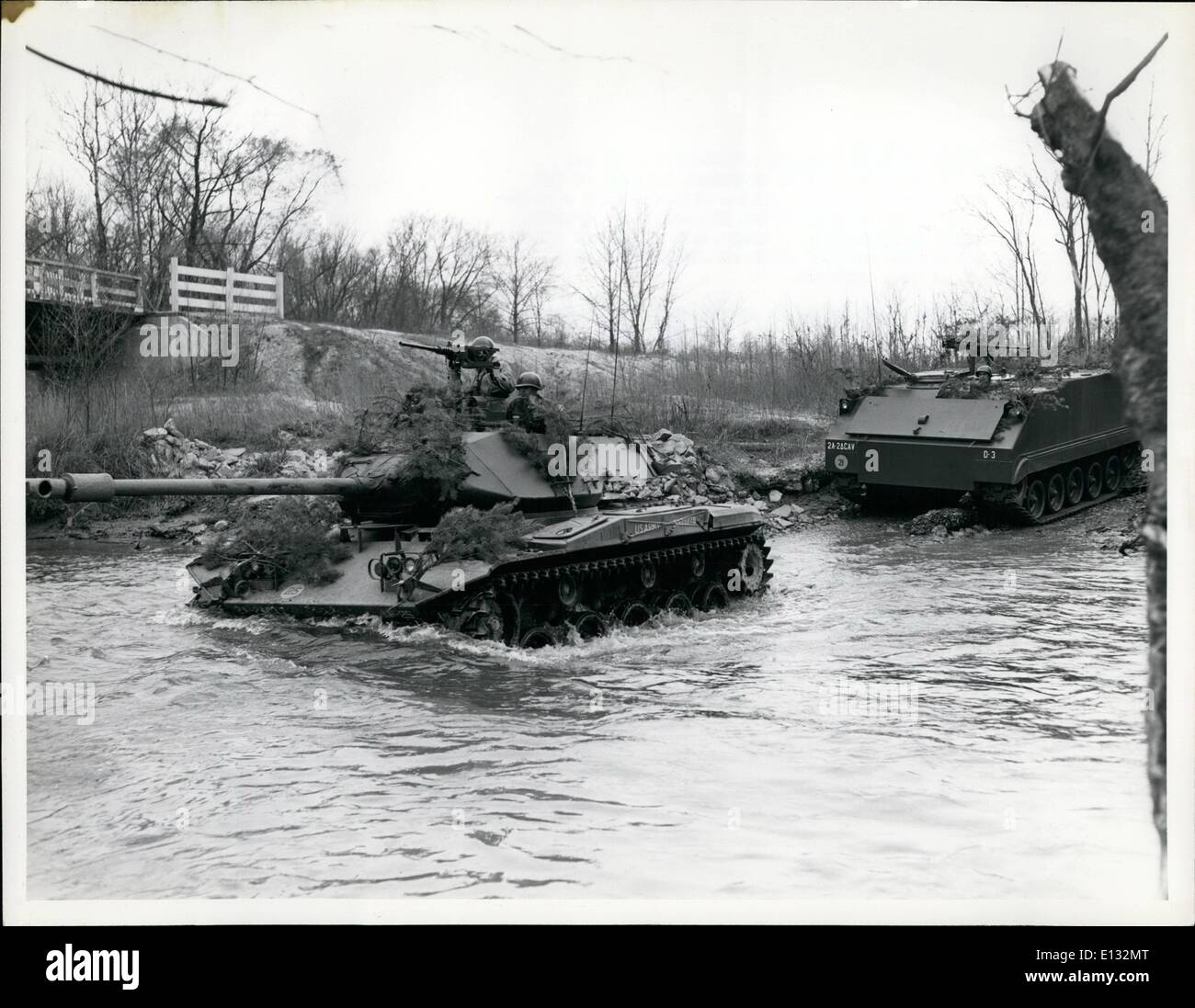 Feb. 26, 2012 - Men of the Second Armored Cavalry - An M-41 Tank and an M-59 armored personnel carrier of the Second Armored Cavalry regiment form a stream during a training exercise in which members of the organization deployed a reconnaissance platoon from a road march position. Other members of the Second Cavalry acted as aggressor troops. Forth George G. Meade, Maryland. May 31, 1957 - Stock Image