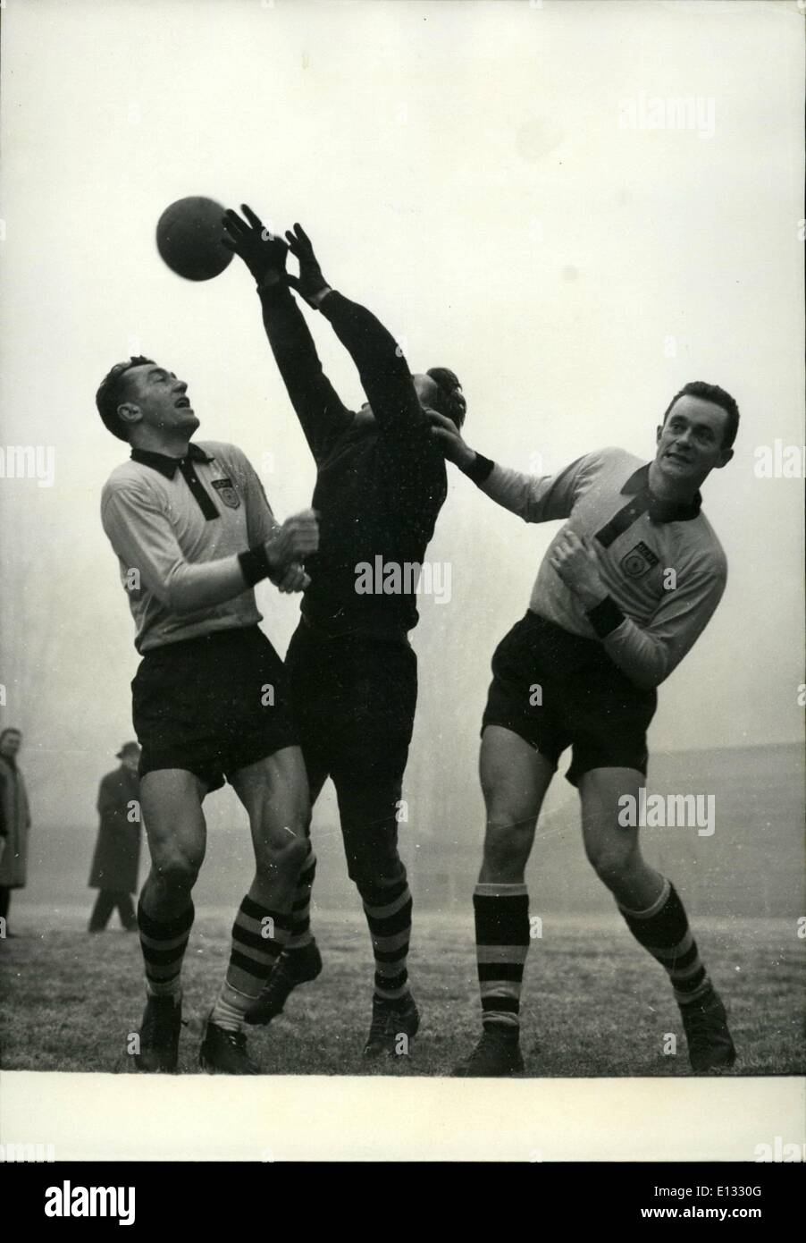 Feb. 26, 2012 - Cycling champions played a football game against sports editors at Jean Bouin, Paris today. The newsmen were beaten by 4 to 3. Bobet (left), as half back and Hassen Forder (as forward) protecting their goalkeeper, Louis Caput. Dec. 5/57 - Stock Image
