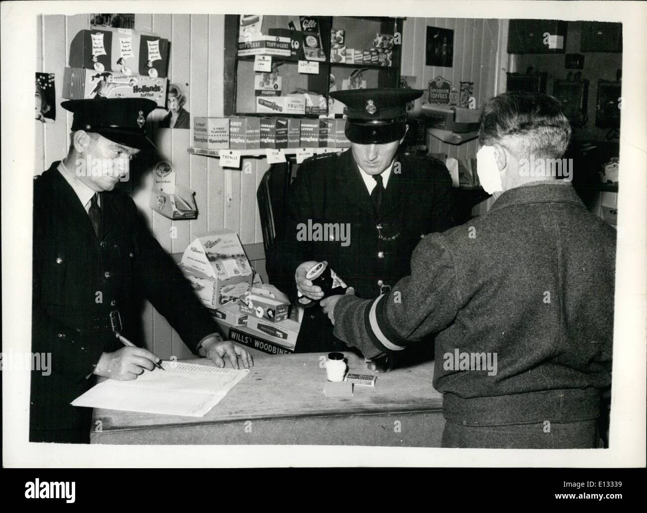 Feb. 26, 2012 - An inmate spending some of the money he has earned at his work in the prison canteen shop. Here he can spend money on sweets, tobacco, jam, hair cream or razor blades, matches etc. He is allowed to earn up to a maximum of four shillings. - Stock Image