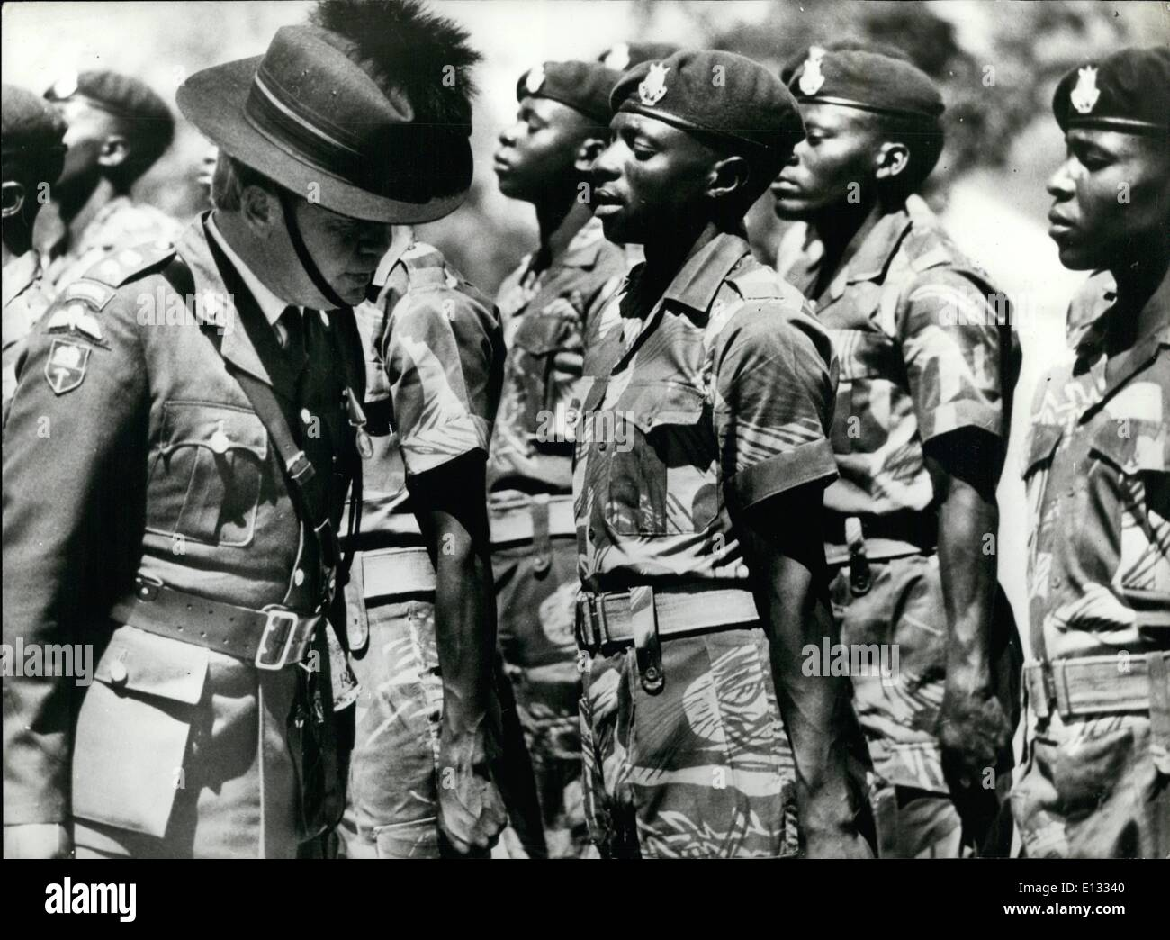 Feb. 26, 2012 - April 1980 Final passing out parade of Rhodesian African rifles. Col. McKenna inspecting the parade of Rhodesian African Rifles at the Shaw Barracks, Bulawayo. At the last passing-out parade before they are integrated into the new Zimbabwe Army. - Stock Image