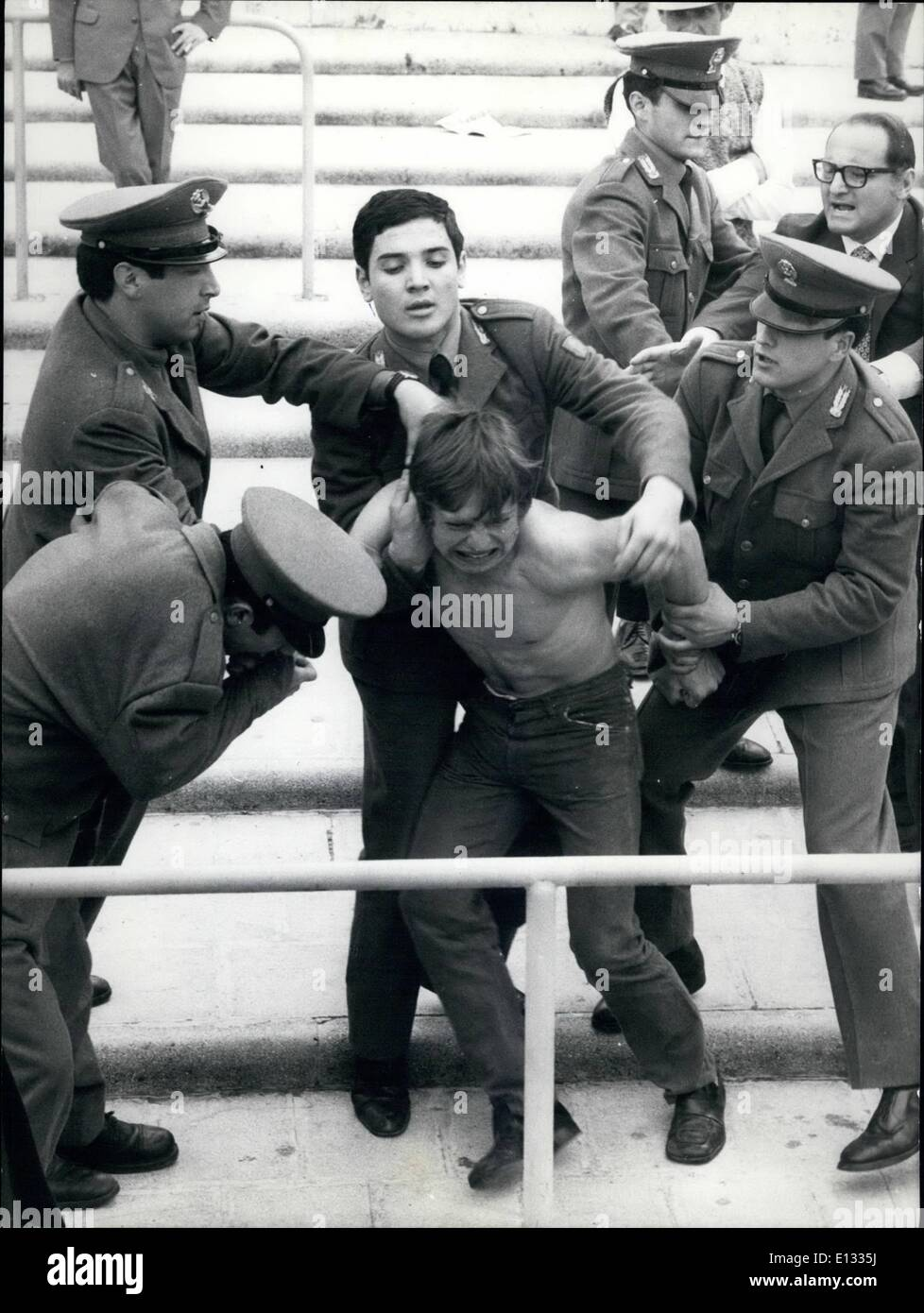 Feb. 26, 2012 - A supporter of the Bari football team, who lost 3-0, the match in Rome against Lazio, was reduced to obedience by four policemen, one of them bits the hand of the unlucky supporter. - Stock Image