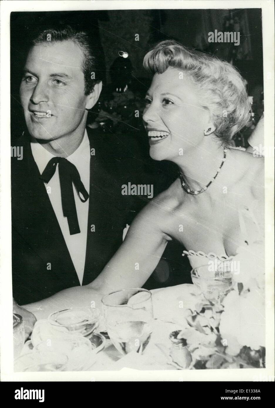 Feb. 26, 2012 - The are called ''Holly wood's happiest couple ' Dinah Shore and husband George Montgomery. claimed to be ''Hollywood''s happiest couple' and acting as if they were still honeymooners are Dinah shore and here comboy star husband George Montgomery - seen when they attended a party in Hollywood recently. - Stock Image