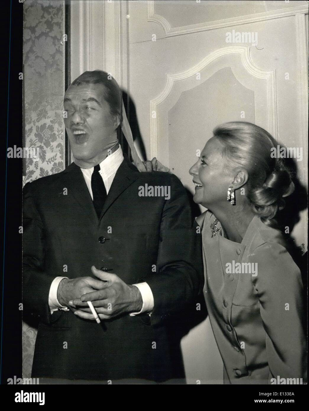 Feb. 26, 2012 - D'you know the man in the stocking?. Hardly recognizable but it is Jean Marais, the famous French Screen actor. Michele Morgan who apart from her professional activity as an actress, has opened a boutique, chose this unusual way of showing off a new line of stocking. Sept. 20/67 - Stock Image