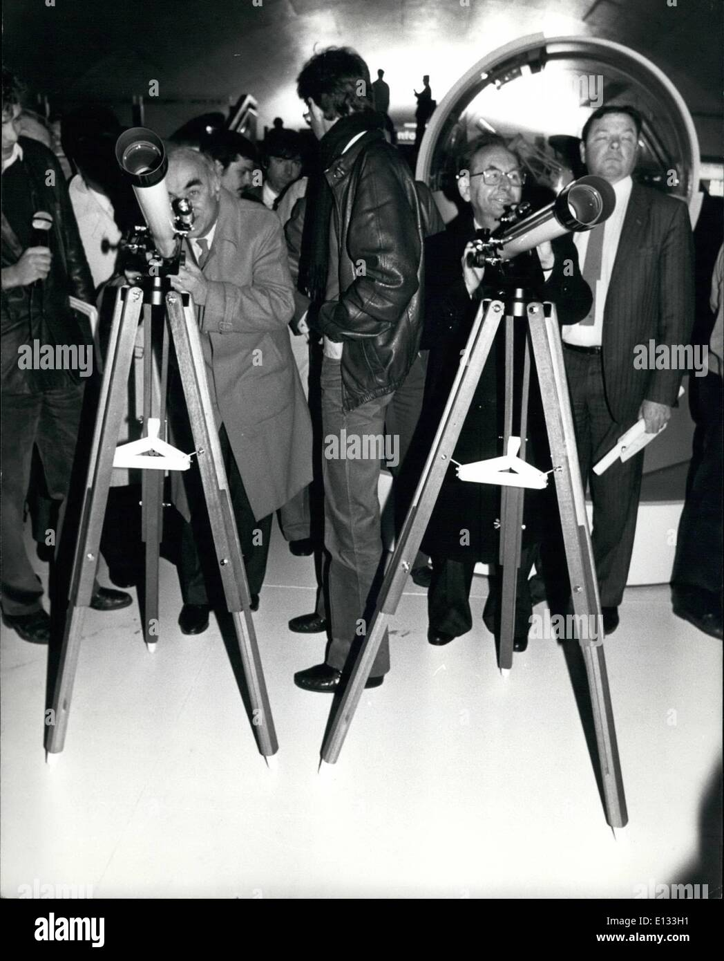Feb. 26, 2012 - NPM/ Le Metro a Ciel Ouvert is an exhibition run by the RATP (Parisian Transports): The passengers will discover the universe through astronomy and space which are a topical issues. Here Hubert Curien Minister of Research and Technology and Claude Quin (right) President of the RATP looking in telescope, at Auber Tube station. - Stock Image