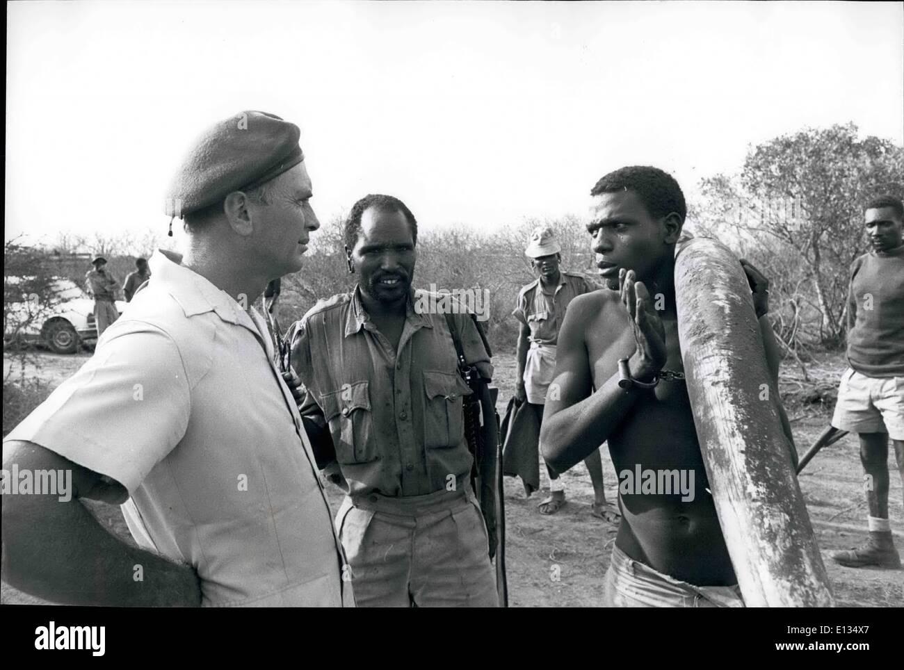 Feb. 28, 2012 - Govt. Against Poachers - Tsavo Natl.Pk., Kenya. David Sheldrick questions the poacher. - Stock Image