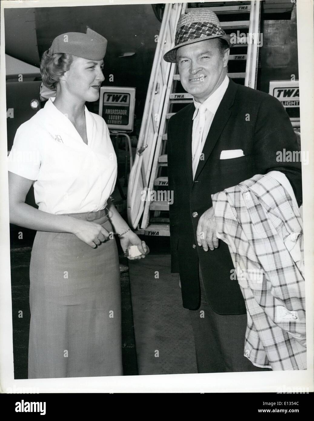Feb. 26, 2012 - N.Y. International Airport, July 29 - Popular Comedian, Bob Hope Is Greeted By TWA Hostess Lucille Stock Photo