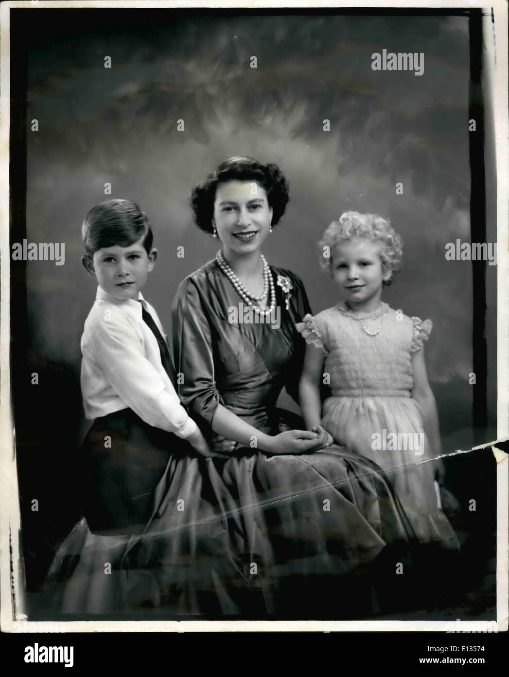 Feb. 28, 2012 - H.M. The Queen With H.R.H Prince Charles and H.R.H. Princess Anne. A new and harming study of H.M. The Queen with her two children Princes Charles and Princess Anne - by Mareus Adams. - Stock Image