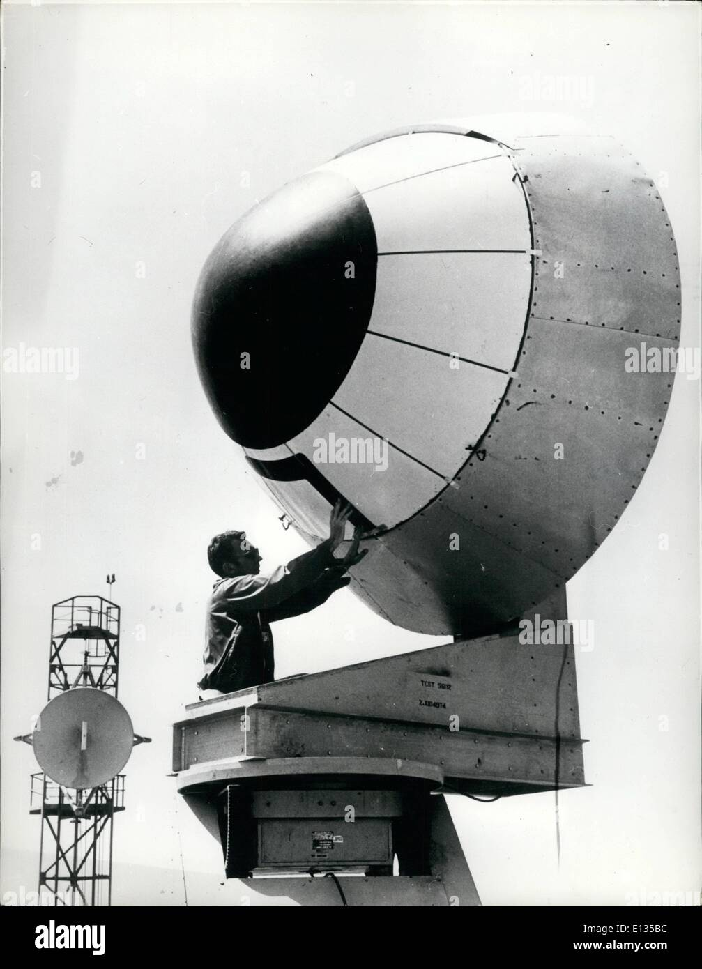 Feb. 26, 2012 - Test For A Mighty Sensitive Snout: An advanced radar system is seen being tested for the new super giant Douglas D.C. 10 Jetcraft. Due to came into service in 1971, the plane will have a sensitive radar system in its 7-ft. diameter nose cone. Capable of radiating 60,000 watts it will have a beam range of 300 nautical miles that will show weather pictures well in advance of the plane's course. Currently being built at Santa Monica, California, the DC 10 will carry up to 345 passengers. Photo Shows DC 10 nose cone housing the long-distance radar system - Stock Image