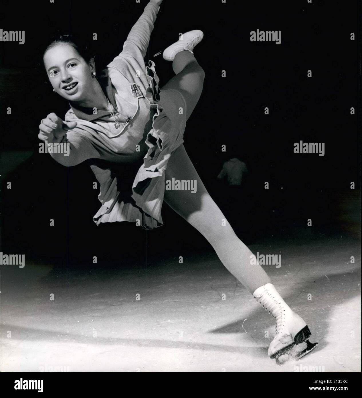 Feb. 28, 2012 - Grace on Ice Yvonne Sugden comes in at high speed. Sixteen years old champion on ice Yvonne spends many hours each day practicing and keeping her body supple and in trim for such feats as this which will bring for England, and herself fresh laurels. - Stock Image