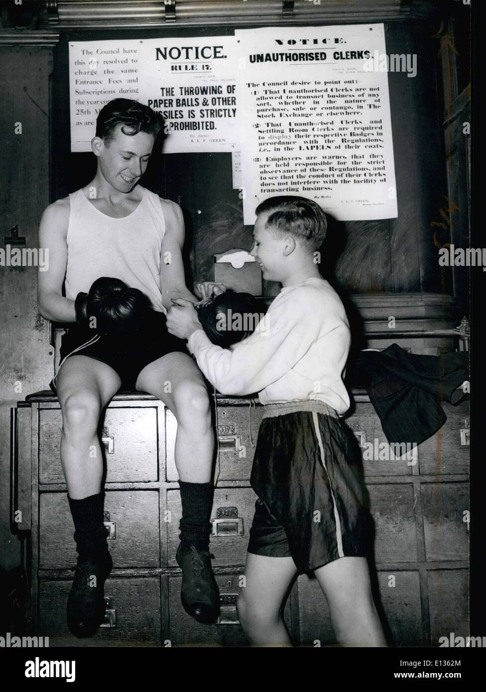 Feb. 28, 2012 - .....But Boxing Is Permitted: When business of the day has finished out come the members of the Stock Exchange Boxing Club to practice with the special permission of the Council, Seventeen-year-old M. Denton and H. Brinlawater much prefer training right at their place of work than elsewhere. - Stock Image