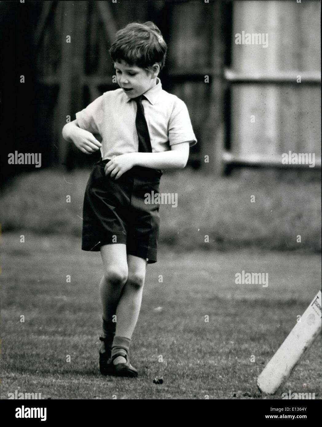 Feb. 28, 2012 - Totally unaware of the photographer catching him 7 years old Viscount Linley gets bored during a game of cricket with some of his classmates. Son of Princess Margaret and Earl of Sweden. - Stock Image
