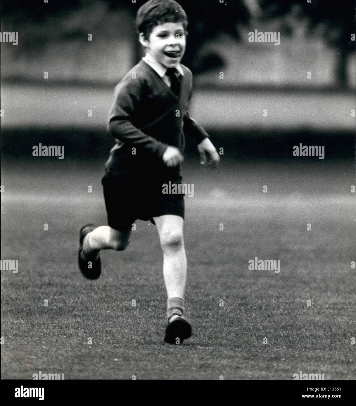 Feb. 28, 2012 - Like any little boy enjoying a game of cricket, 7 year old Viscount Linley runs to retrieve the ball. Son of Princess Margaret and the Earl of Snowdon. - Stock Image