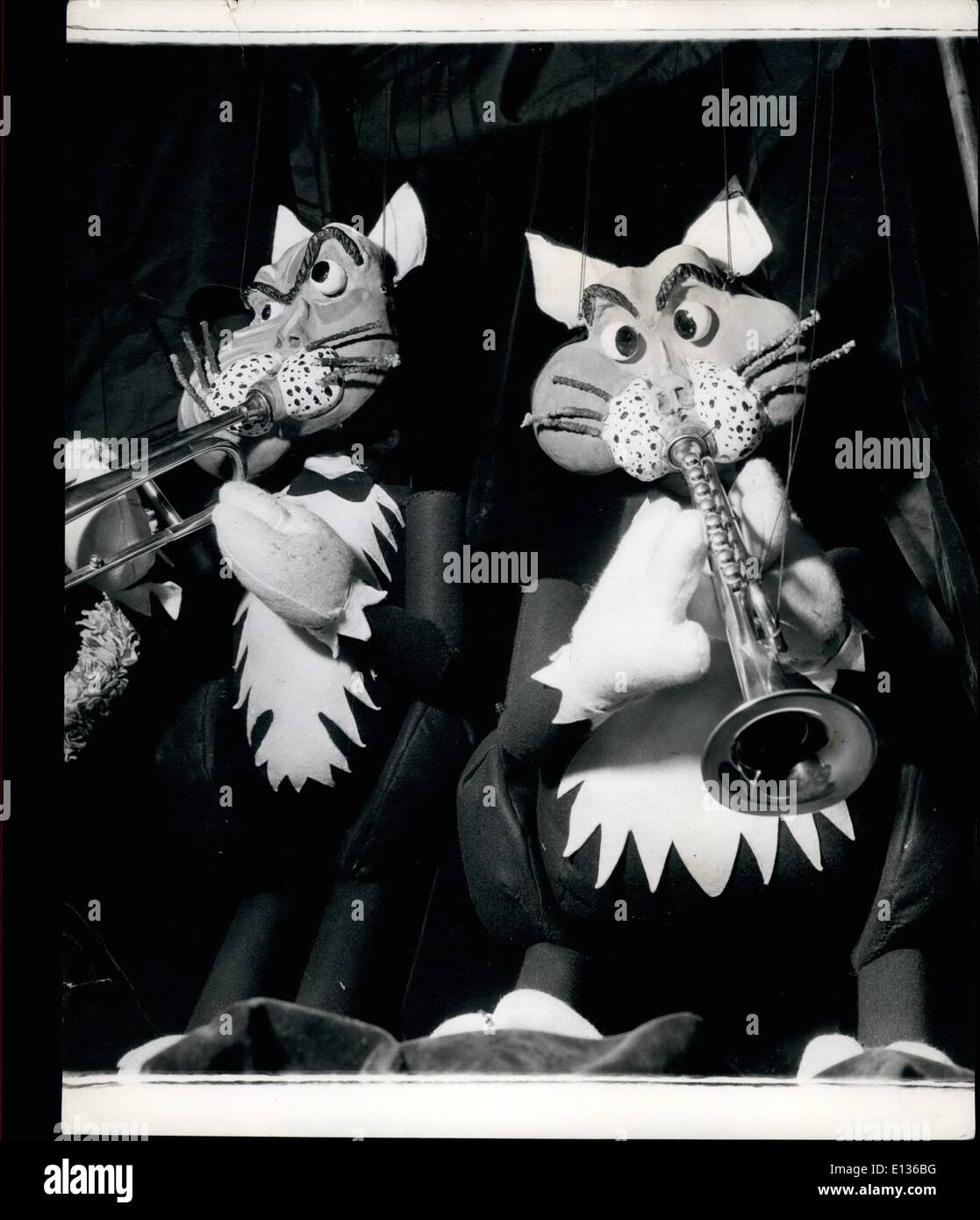Feb. 28, 2012 - Musical Cats N Strings: Making their first appearance at the Palladium are two Australians who have a novel Puppet act. They are husband and wife, Paul and Peta Page, and their clever act has proved a great success with audiences. They have four cat puppets all playing different musical instruments, ''Fats'' at the piano, ''Marmalade'' on the clarjonet, ''Tim'' on the trombone and ''Tom'' on the trumpet, a musical quartette suitably named ''The Hepcats'' - Stock Image