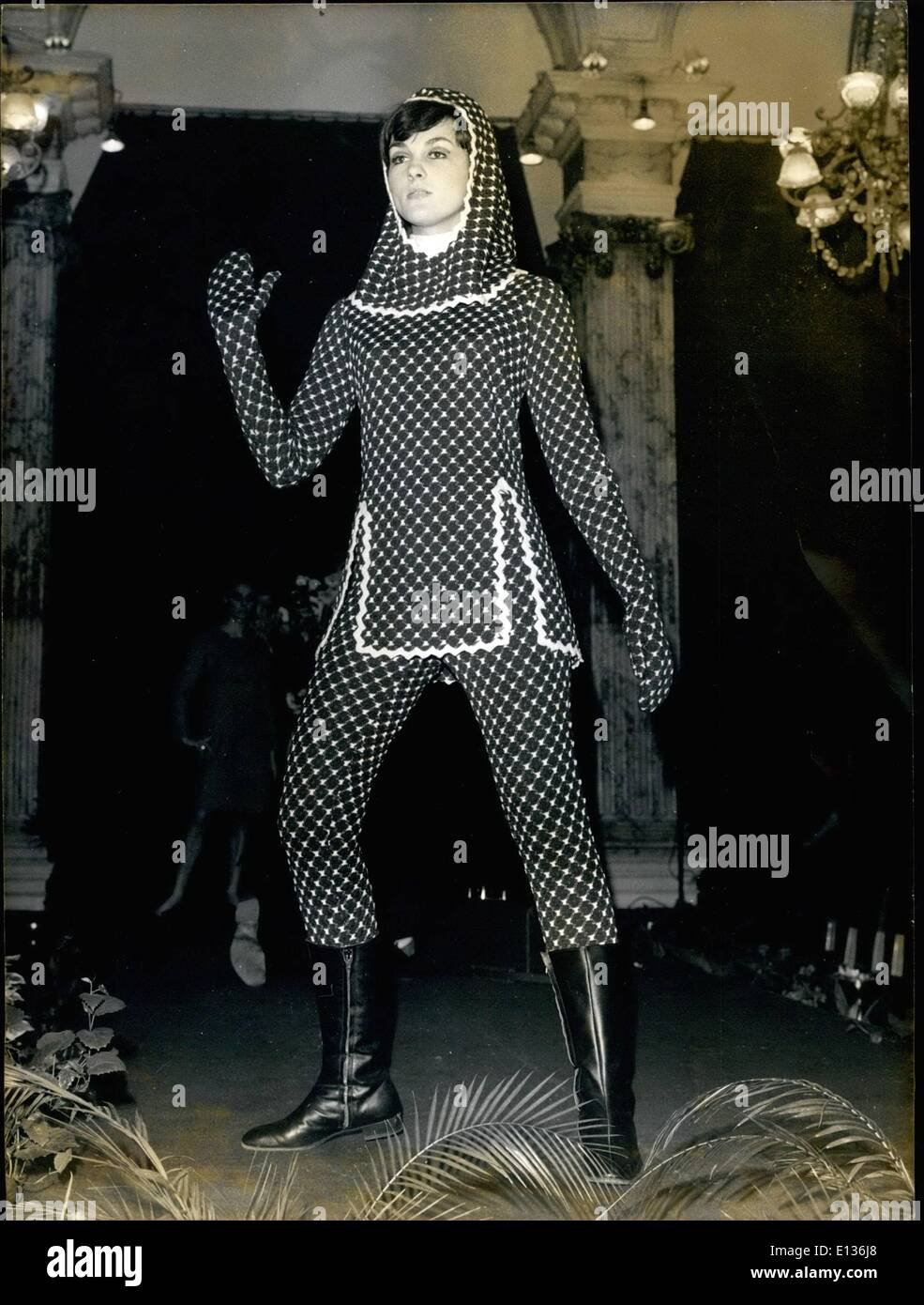 Feb. 28, 2012 - Paris Fashions. Autumn and winter collections are being shown at the Grand Hotel where the Annual Boutique show is being held now. OPS: A woolen jersey three piece suit with hood and mittains of medieval inspiration. April 22/66 - Stock Image