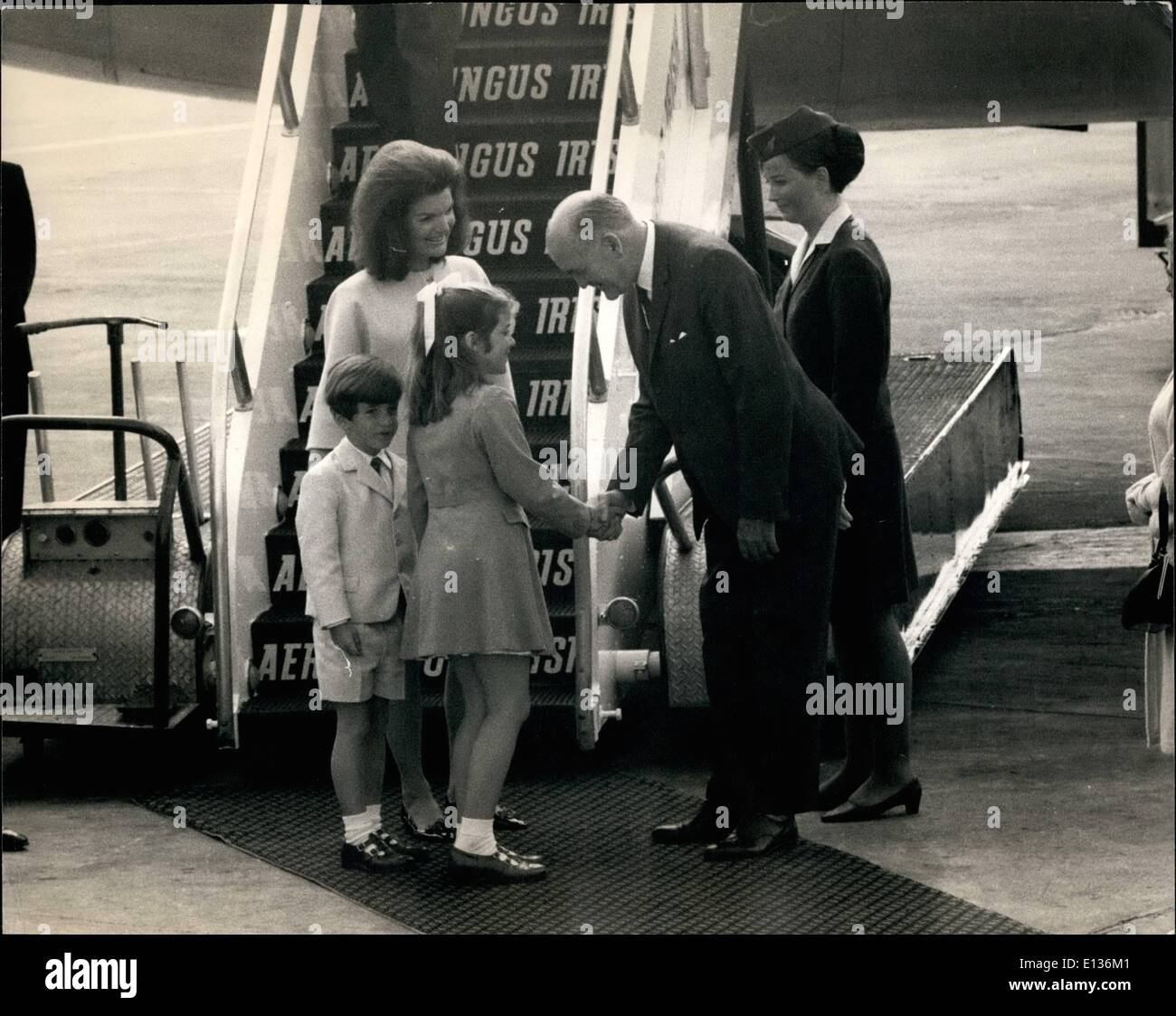 Feb. 28, 2012 - At the foot of the aircraft steps Caroline Kennedy is greeted by Mr Frank Aiken Minister for Irish External Affairs followed by John F. Kennedy junior and Jaqueline. - Stock Image