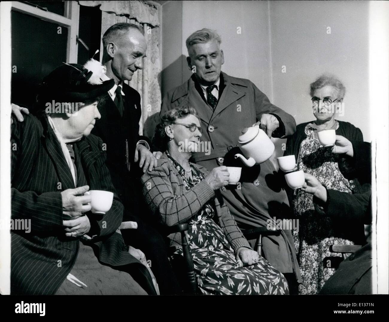 Feb. 28, 2012 - The work of the 11th Crusade: Part of the varied voluntary work by crusaders Sam Jones and Bill Smith is helping at the Dockland Settlement here they are pouring tea for Mrs Barclay, Mrs Baker and Miss Uden, members of the old Age Pensioners Club. - Stock Image
