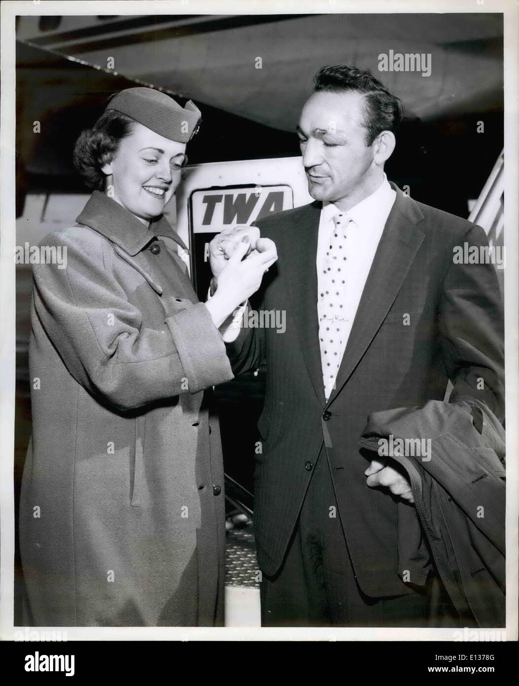 Feb. 29, 2012 - Idlewild Airport, N.Y. Nov. 5 Bosing's Middleweight Champion Carmen Basilio Impresses TWA Hostess Luayine Ohnstad with a huge fist on his arrival here today via TWA from Los Angeles. He attended the opening of IRV Noren's bowling alley in Pasadena last weekend. The former Yankee outfielder, Now with the cardinals, and carmin, are old friends. - Stock Image