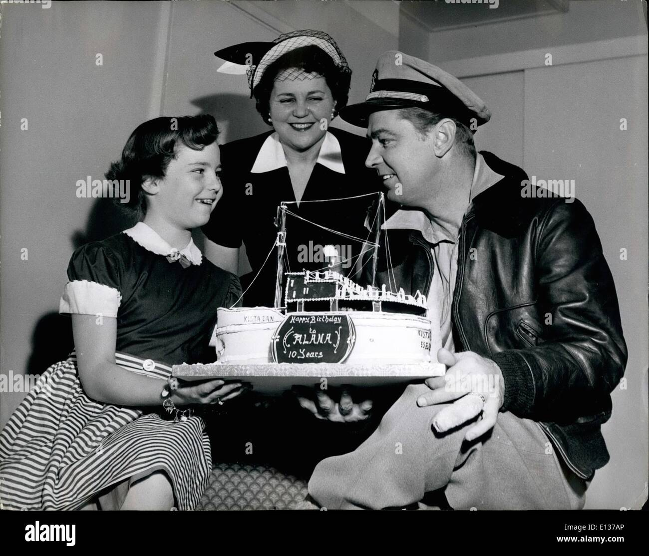 Feb. 29, 2012 - An 'Iced-breaker cake' Alana Ladd's birthday cake was model of the iceship ''Kista dan'': 'Sharing' her birthday with H.M. the Queen, was Alan Ladd's daughter Alana. To celebrate her 10th brithday, cooks at Pinewood,, where Alan Ladd is shooting interior scenes of ''Hell Below Zero'', prepared for her a wonderful iced birthday cake modelled on the ice-breaker 'Kista Dan, in which the Warwick Film Production Unit spent 2 months in the Antarctic on location. Mrs - Stock Image
