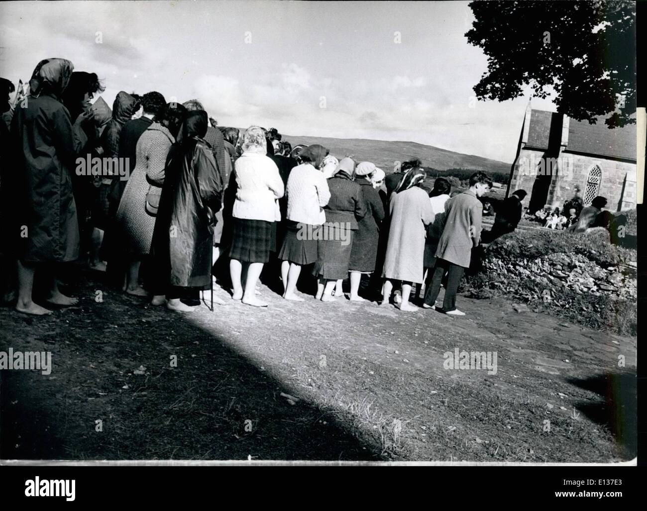 Feb. 29, 2012 - Barefooted pilgrims are seen to line up on the sombre island known as Purgatory. For three days they fast and pray before returning to the mainland. - Stock Image