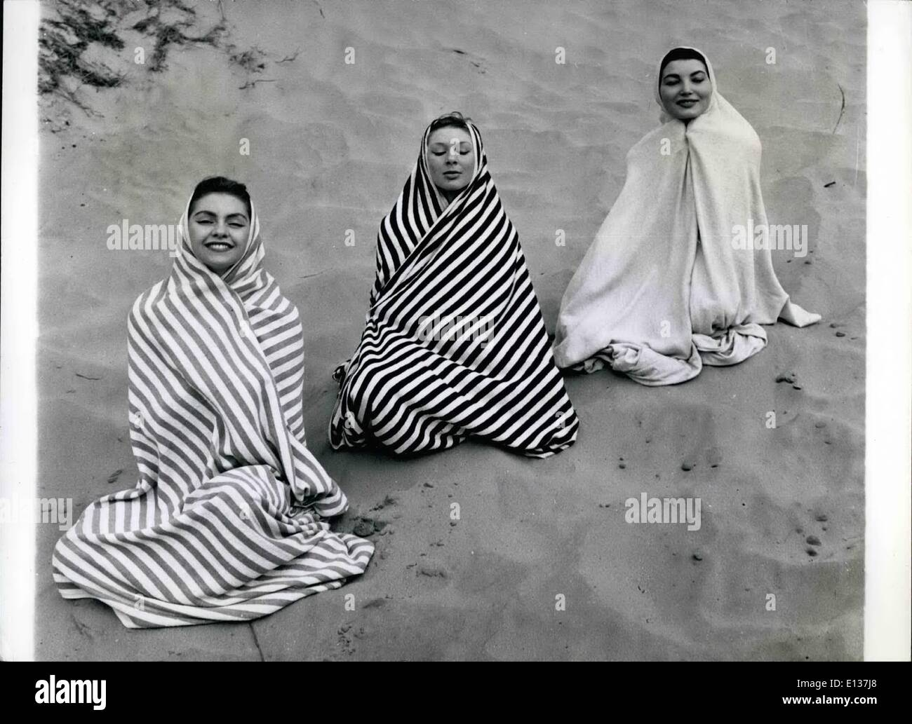 Feb. 29, 2012 - Arabesque: Where Are The Camels And The Palm Trees? Three Smart Girls Use Their Bath Towels As Cloaks And Make This Amusing Picture As They Enjoy Themselves On Camber Sands In Suss Ex. All Are Aida Foster Girls. They Are L-R: Wendy Graham, 18, Patricia Lawrence, 16, And Betty Le Beau, 24. - Stock Image