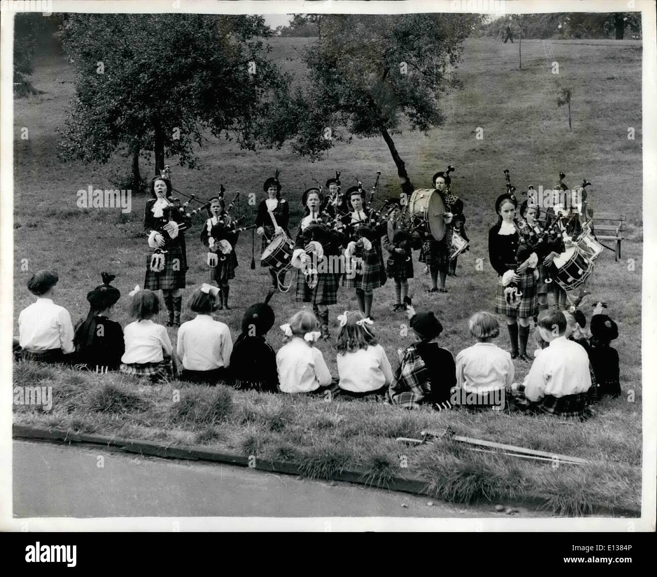 Feb. 29, 2012 - Girl's Pipe Band Formed In A London Suburb: The skir of the pipes is a now a familier sound at Plumstead, where London Scots who attend the Lochnagar School of Highland Danoing, are now forming their own Pipe Band under their teacher Mrs. Gladys Whittall, who has spent 400 of her own money on pipes. Already the band has had a successful B.B.C. audition, played at several charity performances etc. Practice take place at the Dancing School in the evening. The members ages very from 7 to 25, with 9 year old Donald as their mascot - Stock Image