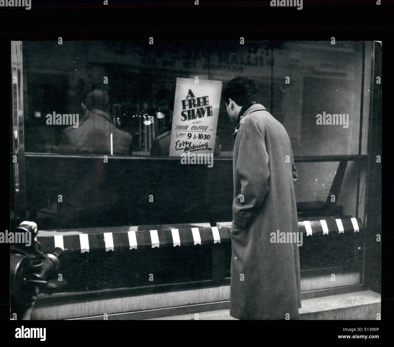 Feb. 29, 2012 - ''Shave with your coffee, Sir?''.: In London's Soho, where many men work strange hours in the catering Stock Photo