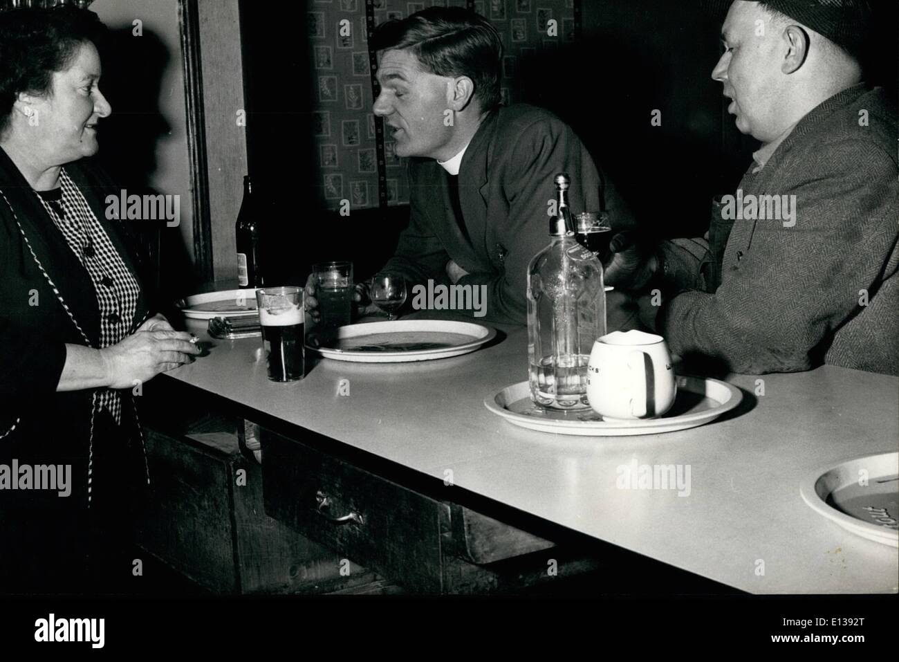Feb. 29, 2012 - The Minister in the Local: A chat over the Bar. After one of his visits to miners at the coalface, The Rev. Cyril Blount calls in at The Forresters Arms and enjoys a drink and a snack and a chat with Grace Morris, the landlord! - Stock Image