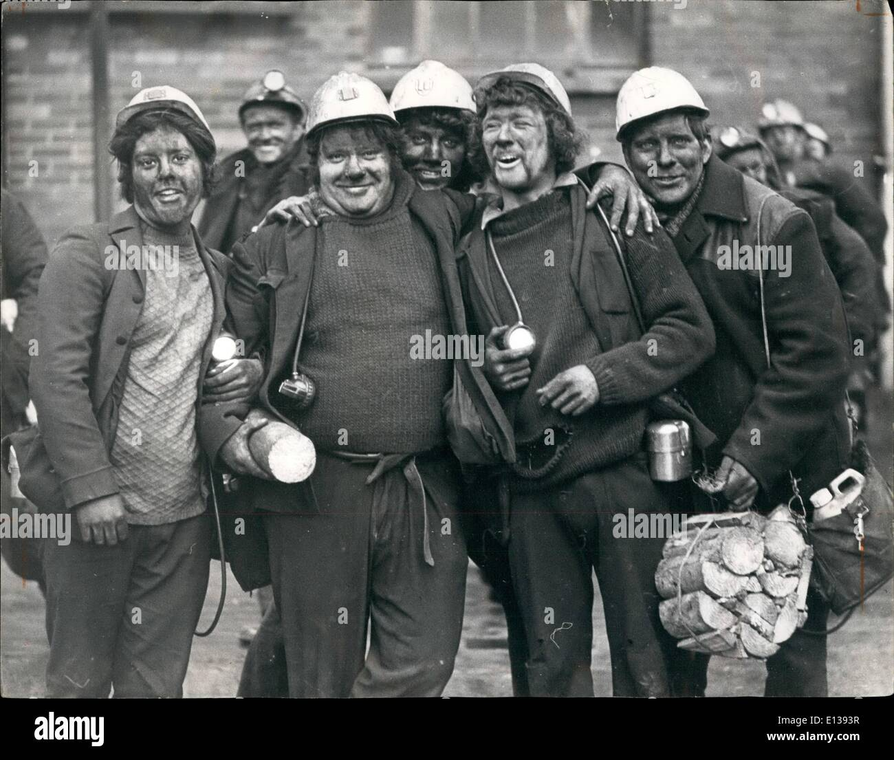 Feb. 29, 2012 - Grime covered miners get together after completing their shift at the Lady Windsor Colliery, Wales. Coprontition Continuts... The crippling threat to Britain's power supplies posed by the industrial dispute between the coal miners and the Government continues, with most of the country working a three-day week. The overtime ban imposed by miners' unions is having a disastrous effect and has pushed he unemployment figures sky high. This picture were taken at the Ynysybwl Lady Windsor colliery in South Wales, recently. - Stock Image