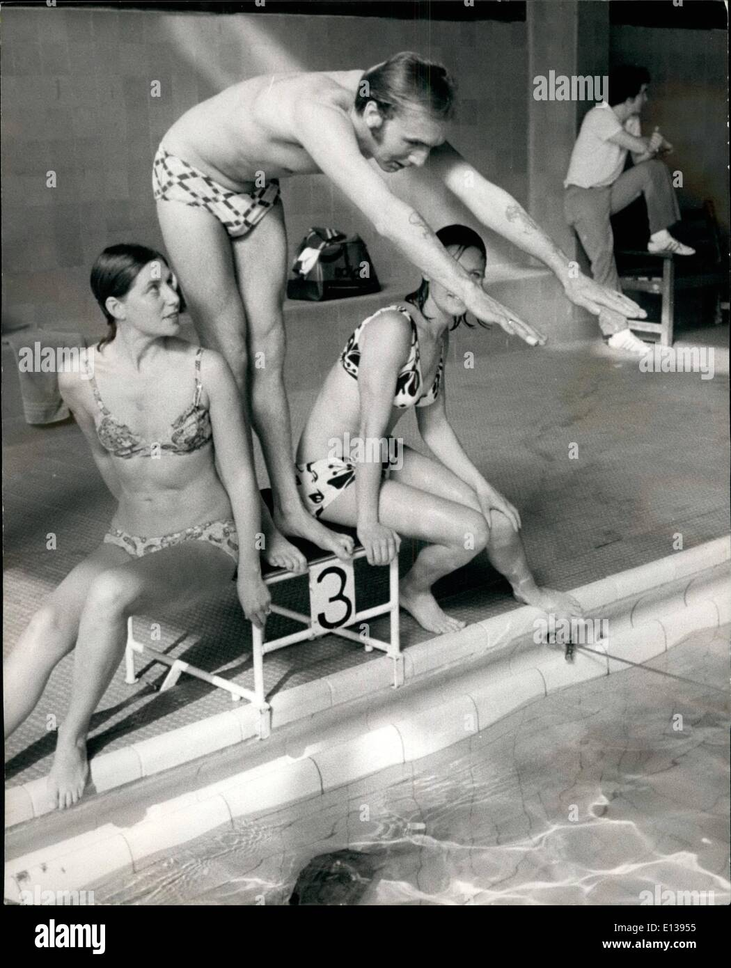 Feb. 29, 2012 - Ray Pert takes the plunge! Two of Ray's fans cheer and encourage him during his swimming training. Here Rap prepares to make a racing dive, the pool at the Gloucester Leisure Centre. - Stock Image