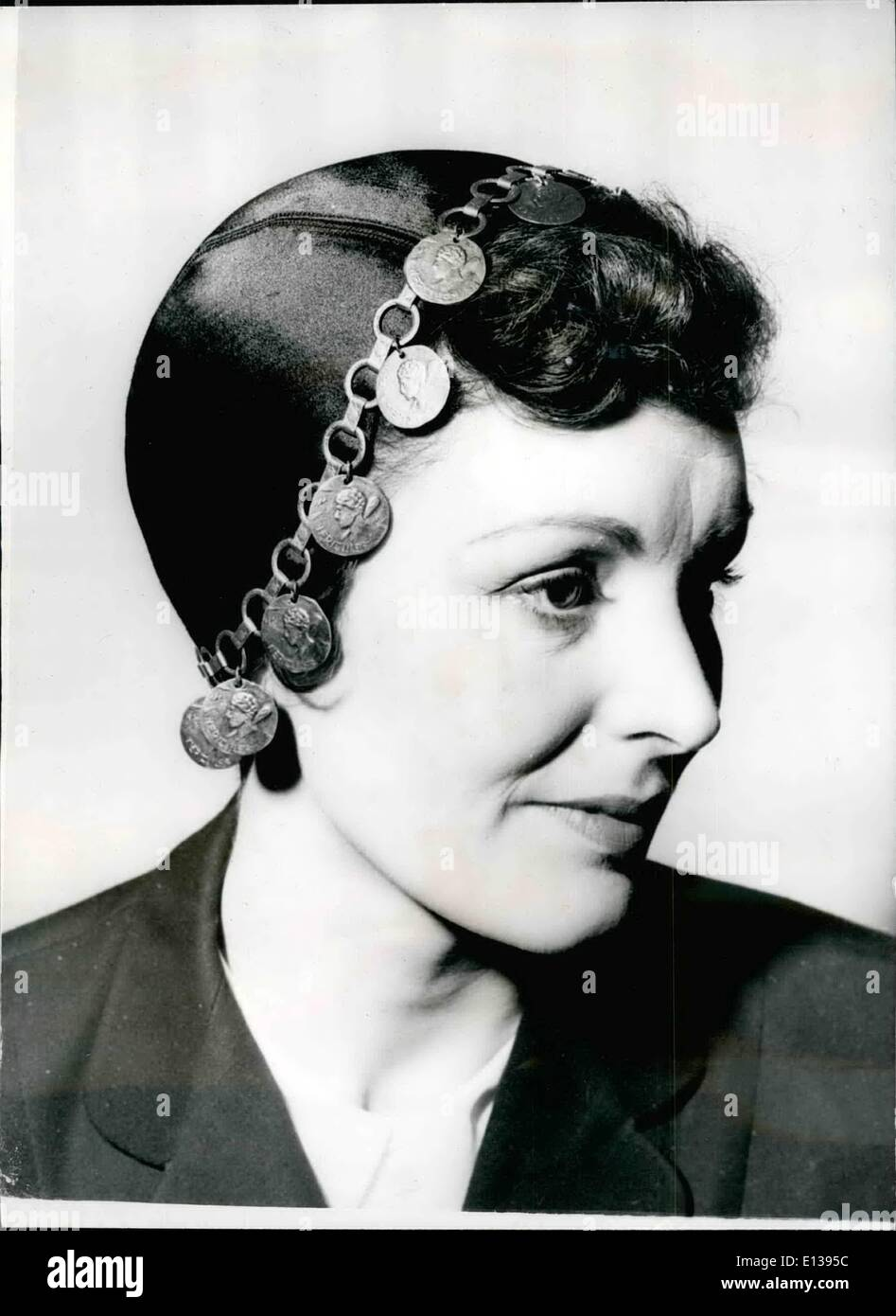 Feb. 29, 2012 - The latest in hat fashions. Juliet cap trimmed with gold coins. Keystone Photo Shows: The black satin Juliet cap, trimmed with gold coins round the edge, seen in the Simone Mirman Collection of new millinery. - Stock Image