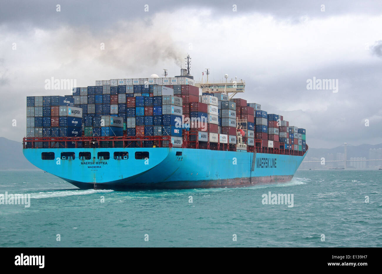 Container ship MAERSK KOTKA (IMO: 9085534, MMSI: 255805595) with containers in Hong Kong - Stock Image