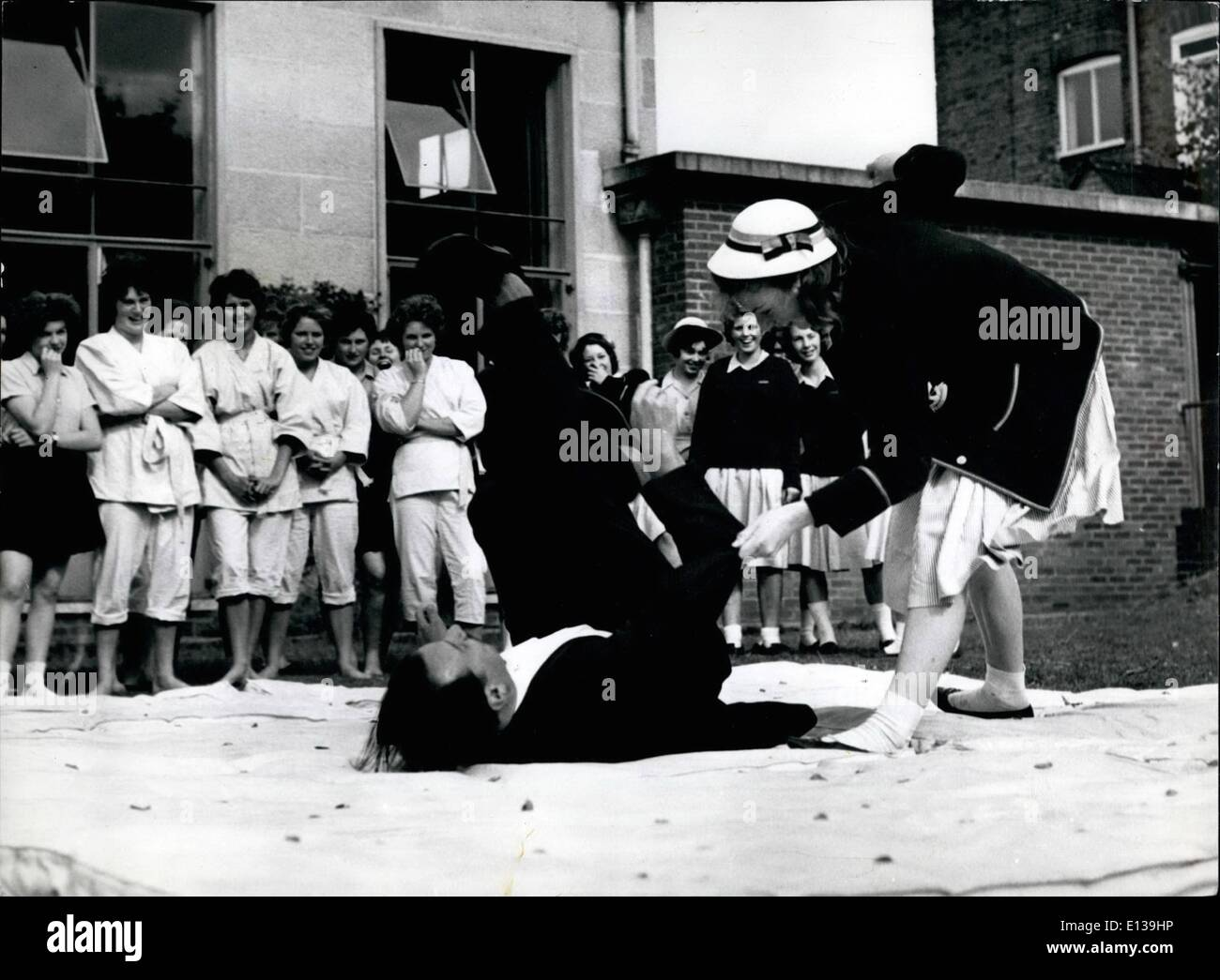 Feb. 29, 2012 - Over he goes: the class laughs as a schoolgirl shows she has mastered are of the Jude holds and throws. - Stock Image