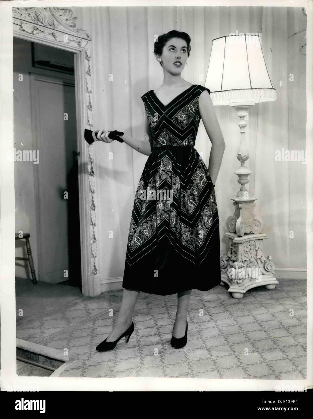 Feb. 29, 2012 - NOT TO BE PUBLISHED UNTIL 23RD. NOV 1953 COCKTAIL DRESS FOR WEAR BY THE QUEEN''S lady in waiting during the royal australian tour.. KEYSTONE PHOTO SHOWS:- A cocktail dress for boat wear in black cotton with a deep 'V' and full skirt.. It is one of the dresses designed by Madame D Lange and shown at the Fortnum and Mason Showrooms,Picadilly- and is for wear by Lady Egerton the Queen's Lady in Waiting during the Royal Australian Tour. - Stock Image