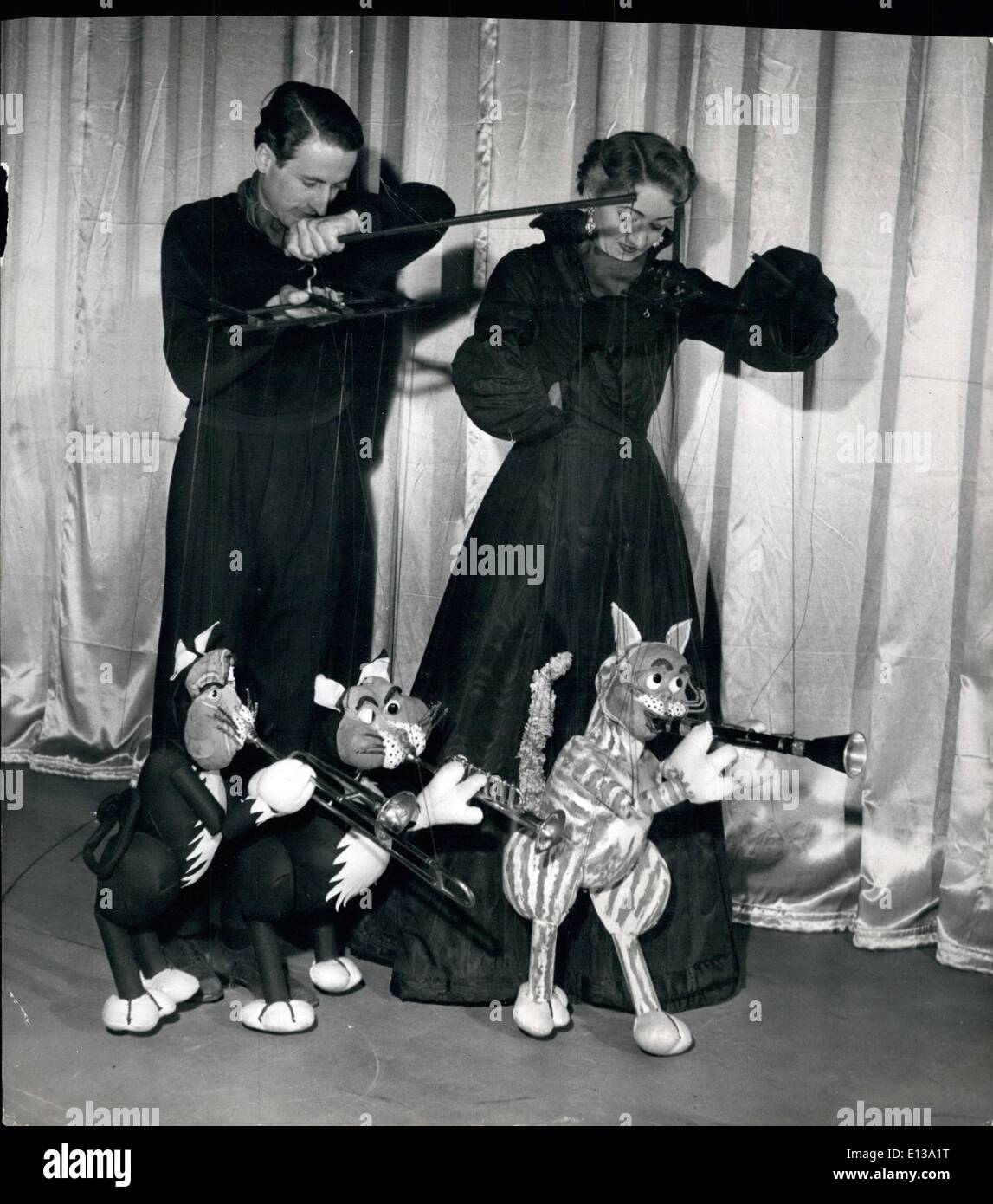 Feb. 29, 2012 - Paul ad Peta Page manipulate the wires which bring their Hepcats to life. The trio here are Marmalade, Tim and Tom. Musical Cats On Strings: Making their first appearance at the Palladium are two Australians who have a novel Puppet act. They are husband and wife, Paul and Peta Page, and their clever act has proved a great success with audiences. They have four cat puppets all playing different musical instruments, ''Fata'' at the piano, ''Marmalade'' on the clarionet, ''Tim'' on the trombone and ''Tom' on the trumpet, a musical quartette suitably named ''The Hepcats'' - Stock Image