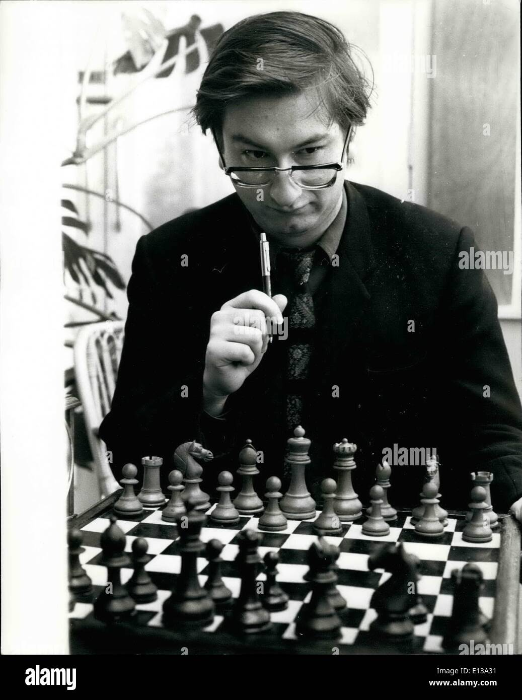Feb. 29, 2012 - Hastings International Chess Congress: The Hastings 46th. International Chess Congress opened today. Approximately 250 players from all parts of the world will be competing. Photo shows. Raymund Keene (England), who is in the Premier Section-studies the board during a practice game at Hastings today. - Stock Image