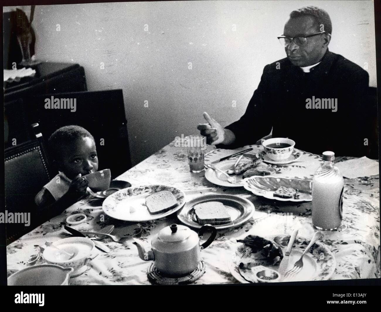 Feb. 29, 2012 - Bishop Muzorewa talks to his baby daughter at the breakfast table. - Stock Image