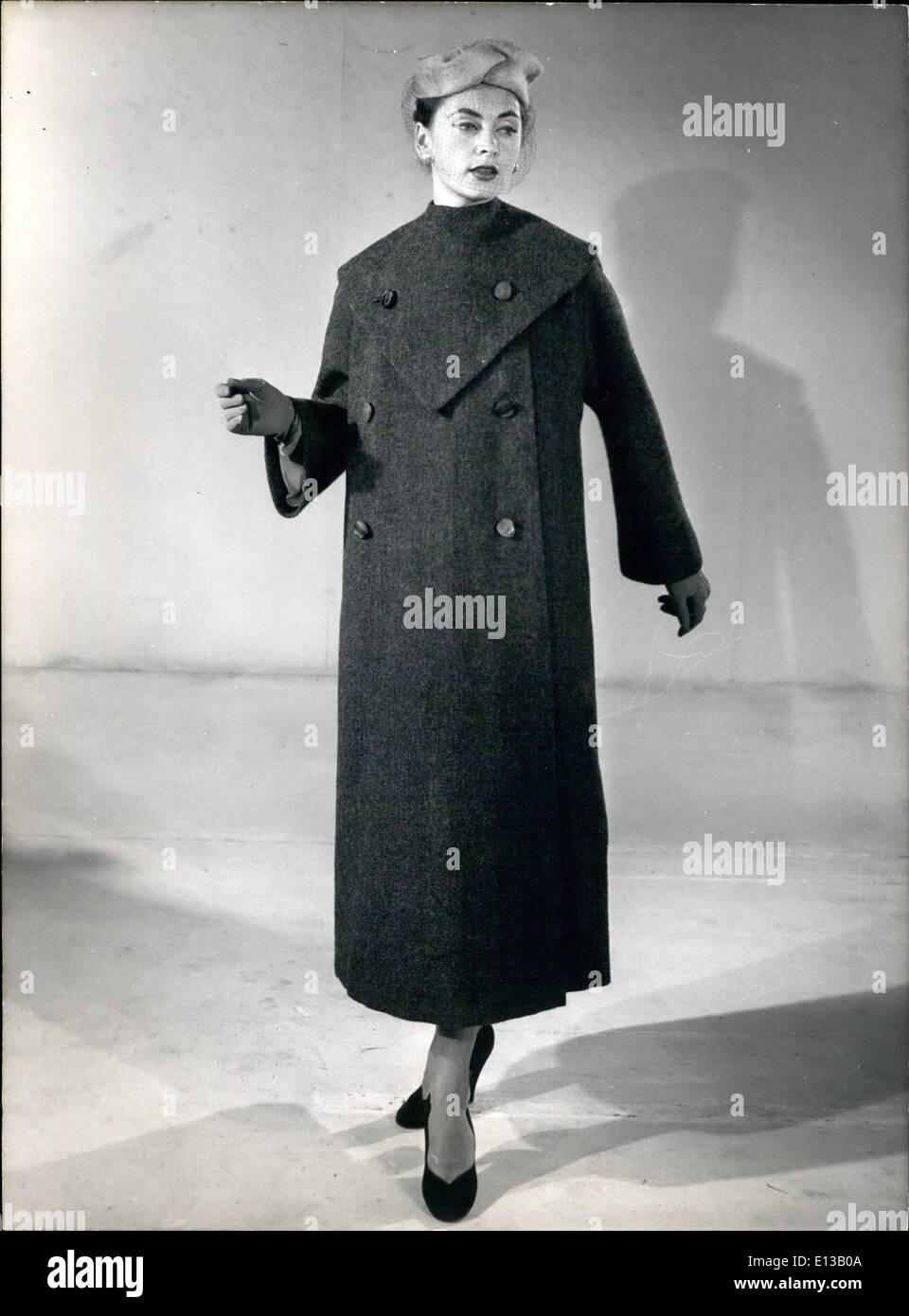 Feb. 29, 2012 - Parisian Fashions for Autumn - Winter 1953 - 1954 ''Bistrat'' coat in dark green shetland with buttoned Plastroni. - Stock Image