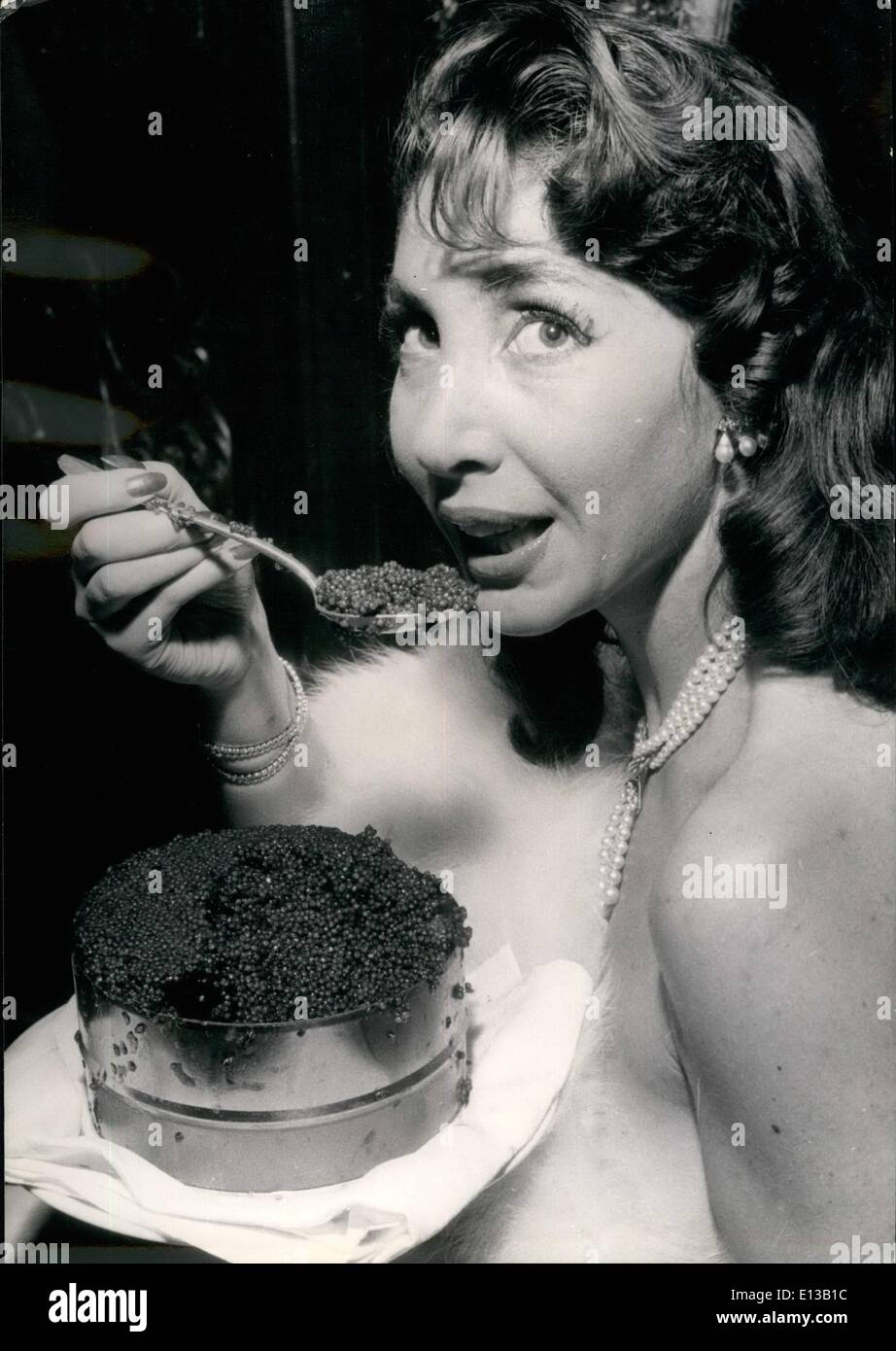 Feb. 29, 2012 - Meet Queen of Caviar. 28 year old Dominique Varga, a cabaret singer, was elected Queen of Caviar at a party held at the Auberge D'Amaille, one of the Paris most famous restaurants. The new ''Majesty '' was given as a present... Her weight in Caviar (A costly present a kilo of caviar being sold at 5!). OPS Dominique tasting caviar, out of the boxes she received as a present. - Stock Image