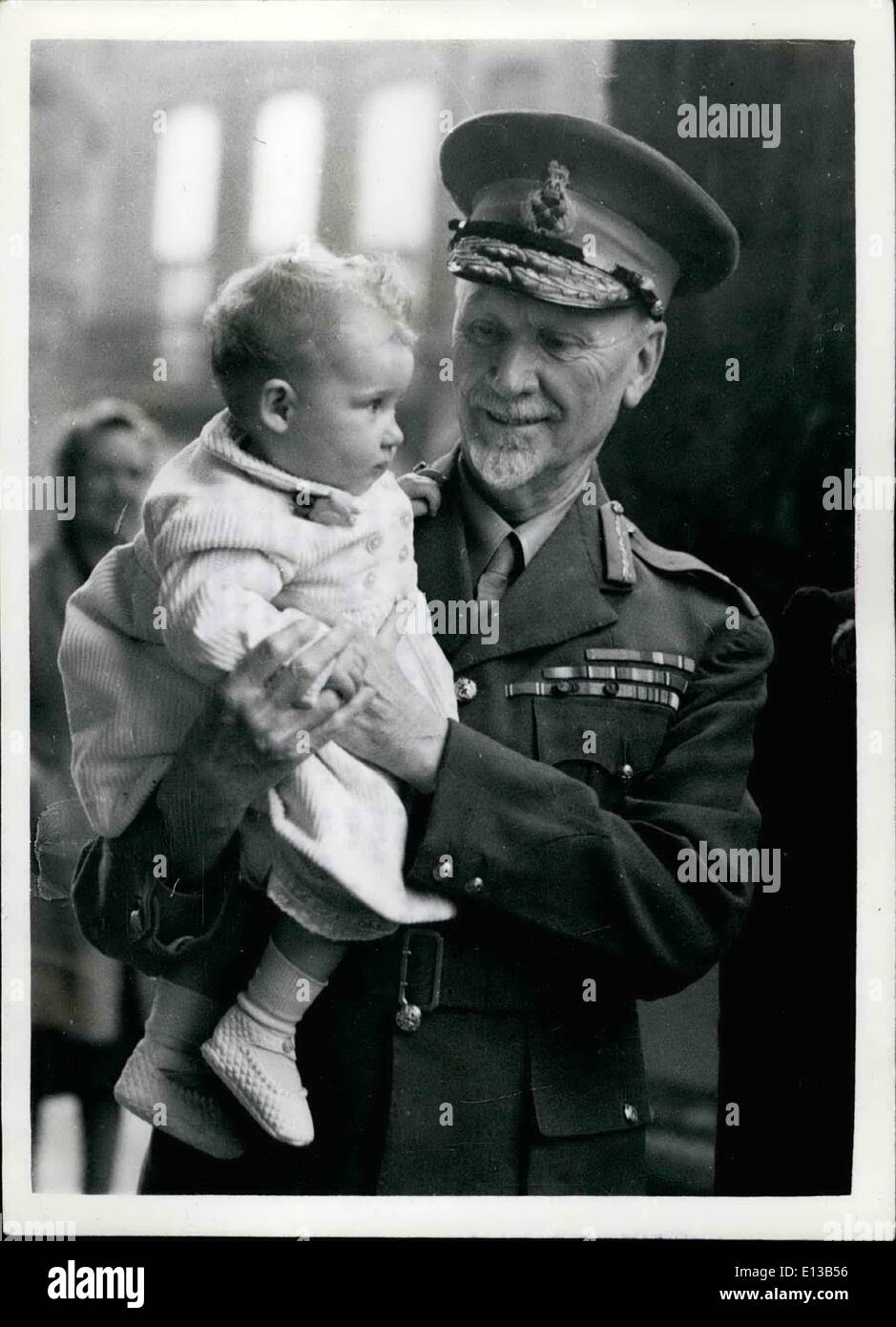 Feb. 29, 2012 - General Smuts becomes Godfather.: Gen. Smuts has become the Godfather of little Angela Petrina Huge, the daughter of Group Captain and Mrs. Peter H. Hugo. Hugo who is only 25, is a veteran of the Battle of Britain and a well known South African air ace.He helds the D.S.O. and D.F.C., with tow bars. He could not attend the ceremony which took plae at St. George's, Hanover Square - for he is now in the Mediterranean Theatre of War. Angela's mother, former Miss Angela Seeds, is a V..D. Nurse and comes from Anglesey, Wales - Stock Image