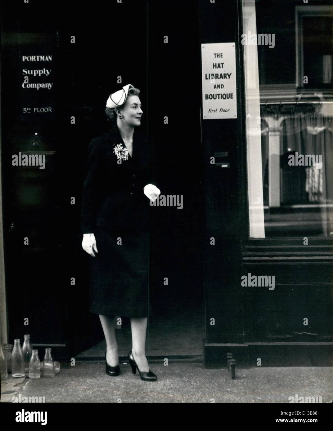 Feb. 29, 2012 - Hats Unlimited: A Millinery Model Service For Madame: Miss Gloria Reed leaves the Hat library wearing the hat she has selected for her outing. It is an exact, hand-made replica of that worn by Her Majesty on her return to London. - Stock Image