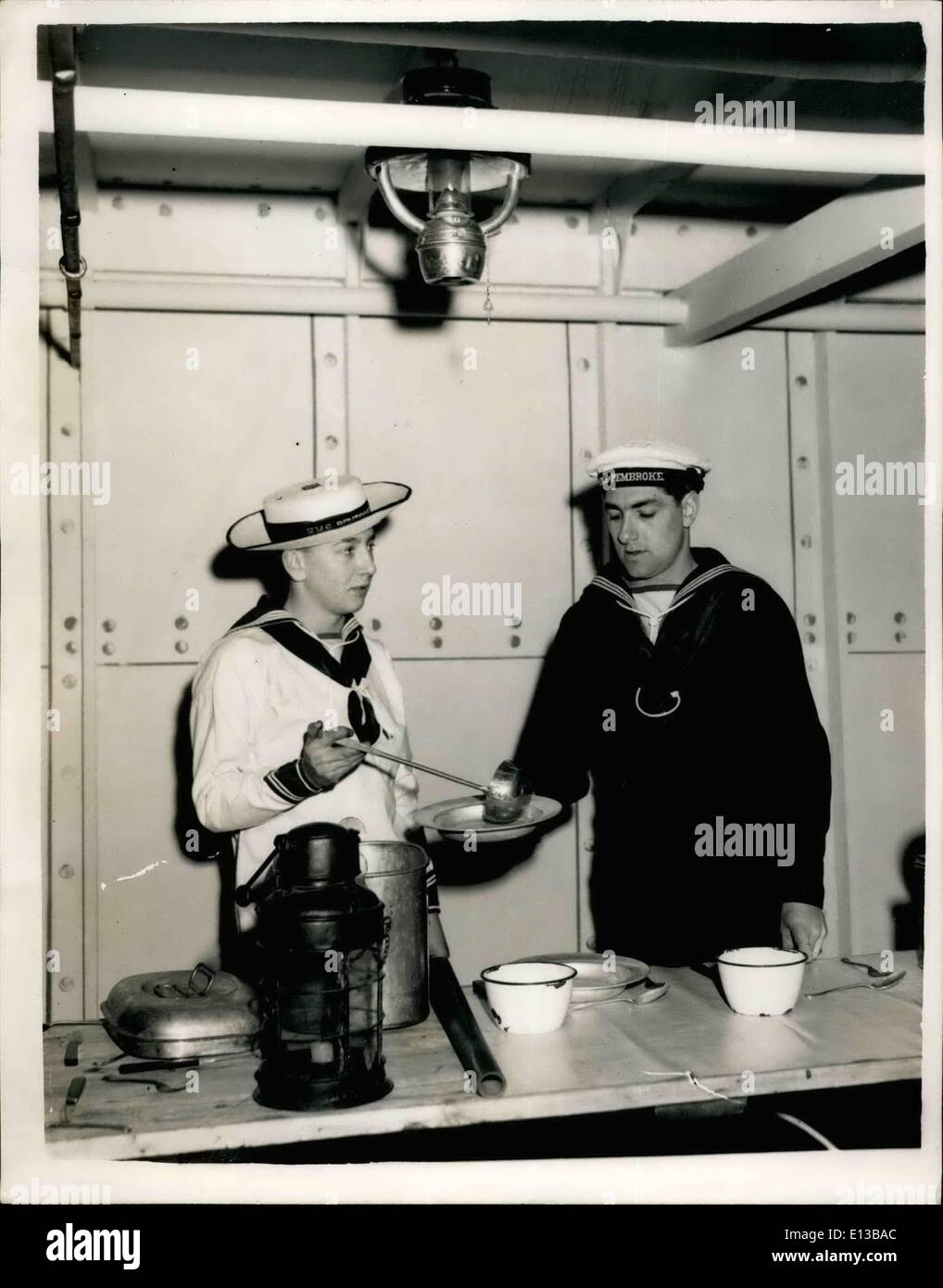 Feb. 29, 2012 - Preparations are going ahead at Chatham for the Easter Navy Days - which incorporates celebrations of the fiftieth anniversary of the Royal Naval Barracks. Keystone Photo Shows - Dressed in the gear of ffifty years ago - Left 'Boy' John Willsher of Morden serves food to Stoker Sidney Goodall of the Waltham Abbey - during preparations at Chathan for Easter Navy Days, - Stock Image
