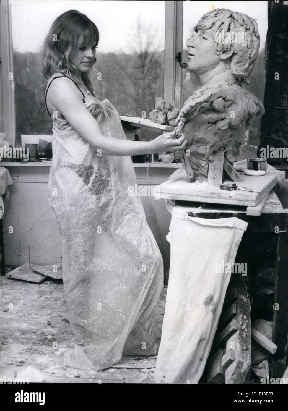 Feb. 29, 2012 - Working in clay is dusty work - hence the plastic wrapping round sculptress Liz Moore while she works on a bust - Stock Image