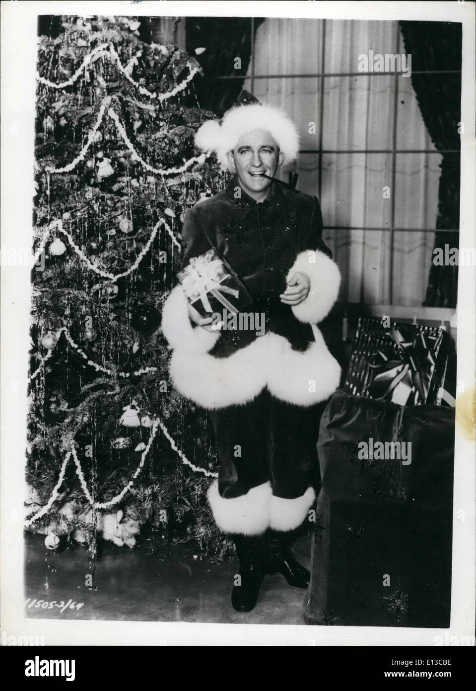 Feb. 29, 2012 - Crooner In A New Role. Santa Bing! Although he has dispensed with the traditional beard - crooner Bing Crosby makes a wonderful Father Christmas. He is seen in the clothes he wears in the new film ''White Christmas'' - which is being made in VistaVision - Hollywood. - Stock Image