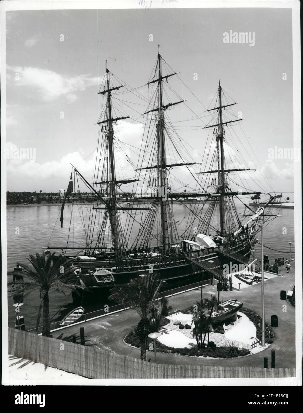 Feb. 29, 2012 - The Bounty, famed ship used in the Metro Goldwyn-Mayer movie, is now on permanent exhibits at St. Petersburg, Florida. To keep the exact replica of the original 18th century vessel shape master craftsman Clarence Carlson is constantly busy doing repair work. He has recently replaced the tall center mast, hand tooled from a Douglas fir weighing seven tons and ten times older than the original Bounty. Whittling the giant tree down to size required expert craftsmenship. - Stock Image