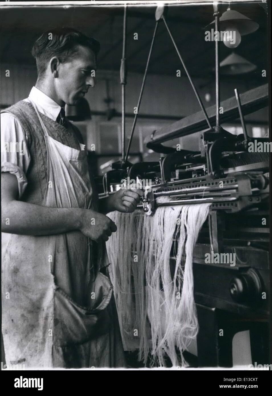 Feb. 29, 2012 - Warp Ting; Mr. John Fehay operates a warp tying machine. - Stock Image